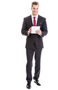 Businessman with tablet pc cheerful young working a modern computer full length shot Royalty Free Stock Photography
