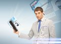 Businessman with tablet pc reading news Stock Photography