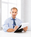 Businessman taking employment inteview picture of handsome Royalty Free Stock Images