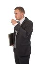 Businessman is taking a small coffee break Royalty Free Stock Photo