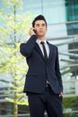 Businessman talking on cellphone outdoors portrait of a Stock Images
