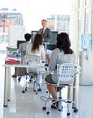 Businessman talking in front of his team Royalty Free Stock Photo