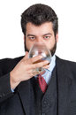 Businessman tasting a glass of whisky Royalty Free Stock Images