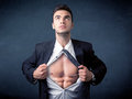 Businessman tearing off shirt and showing mucular body Royalty Free Stock Photo