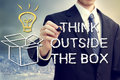 Businessman with think oustide the box drawing thinking outside theme Stock Photo