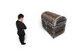 Businessman thinking and looking at old treasure chest Royalty Free Stock Photo