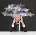 Businessman thinking with storm cloud Royalty Free Stock Photo