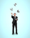 Businessman throwing and catching d money symbols sliver Stock Images
