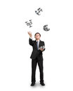 Businessman throwing and catching sliver money symbols d isolated in white background Royalty Free Stock Photography