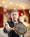 Businessman throws a coin close up of Royalty Free Stock Photography