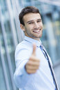 Businessman with thumbs up portrait of young business man smiling Stock Photography