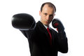 Businessman with a tie and boxing gloves punching Stock Photo