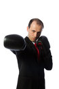 Businessman with a tie and boxing gloves punching Royalty Free Stock Image