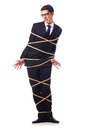 Businessman tied up with rope Stock Images