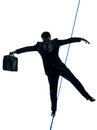 Businessman tightrope walker silhouette one caucasian in studio isolated on white background Stock Photography