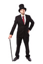 Businessman with top hat and walking stick in a suite Stock Photos