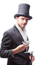 Businessman with top hat and walking stick in a suite Stock Photo