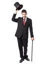 Businessman with top hat and walking stick in a suite Royalty Free Stock Photos