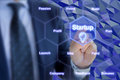 Businessman touches startup hexagon grid