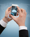 Businessman touching screen of smartphone business internet and technology concept and cloud in it Royalty Free Stock Photo
