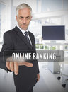 Businessman touching the term online banking in his office Royalty Free Stock Photos
