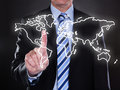 Businessman touching world map on the screen Royalty Free Stock Photo