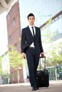 Businessman traveling with bag portrait of a Stock Photo