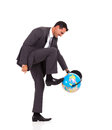 Businessman turning globe Stock Images