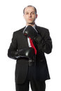 Businessman tying a tie with boxing gloves Royalty Free Stock Photos