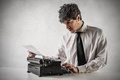 Businessman typing on an hold typewriter Royalty Free Stock Photography
