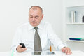 Businessman typing message sitting in the office and Royalty Free Stock Image