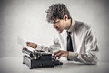 Businessman typing on the typewriter writing and an old Stock Photo