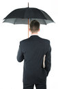 Businessman with an umbrella and a newspaper Royalty Free Stock Images