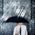 Businessman with umbrella protecting himself from percentage rai rain concept of share profits credit money loan interest finance Royalty Free Stock Image