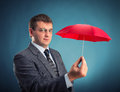 Businessman with an umbrella red Royalty Free Stock Image