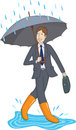 Businessman with an umbrella and in rubber boots smiling in the rain Stock Photo