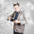 Businessman under falling money financial success creative design portrait of a wealthy counting american dollar bills in wallet a Royalty Free Stock Photos