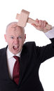 Businessman under pressure smashing head isolated on white Stock Photography