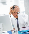 Businessman under stress fatigue and headache he kept his hands behind his head Stock Photography