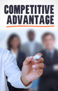 Businessman underlining the word competitive advantage in front of a business team Stock Photo