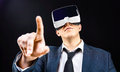 Businessman uses virtual reality vr head mounted display using his glasses Stock Image