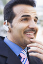 Businessman using bluetooth earpiece Stock Photos