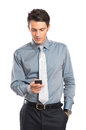 Businessman using cell phone young with hand in pocket isolated on white background Stock Photos