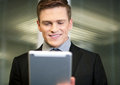 Businessman using digital tablet corporate guy pc at workplace Stock Photography