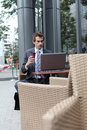 Businessman using his laptop in cafe Royalty Free Stock Photography
