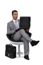 Businessman using a laptop Stock Images