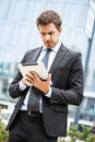 Businessman using a tablet Stock Images