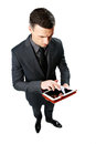 Businessman using tablet computer isolated on a white background Stock Photo