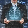 stock image of  Businessman using tablet showing AI, artificial intelligence con
