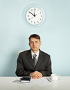 Businessman waiting in an office at the workplace Stock Images